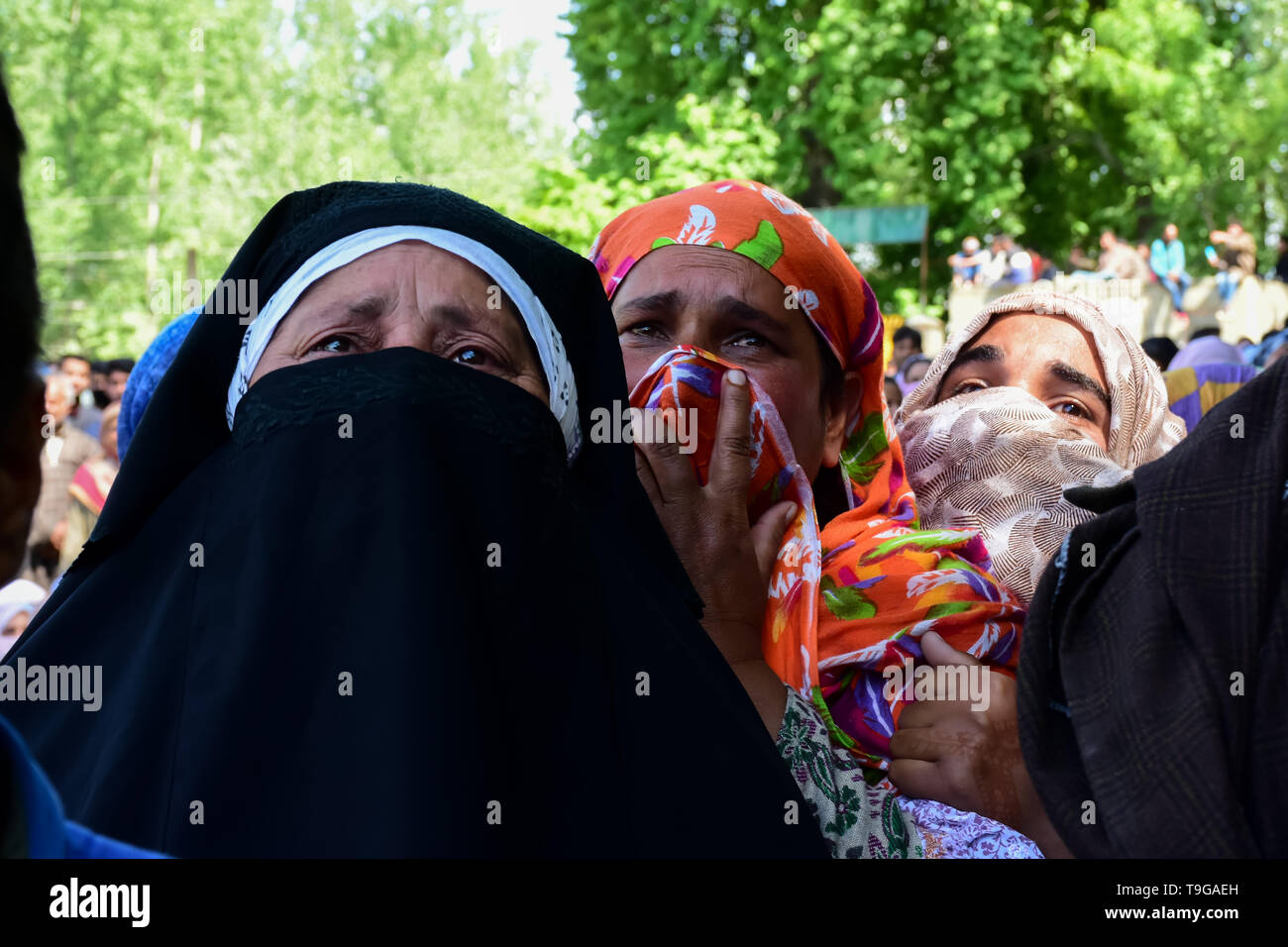 Relatives of the Slain Showkat Ahmed are seen mourning during the funeral ceremony at his residence in Pulwama, South of Srinagar. Thousands attended the funeral ceremony of slain Showkat Ahmed Dar at his residence in Panzgam Pulwama. Showkat was among the three Kashmiri Rebels killed in a gunfight in Pulwama. - Stock Image