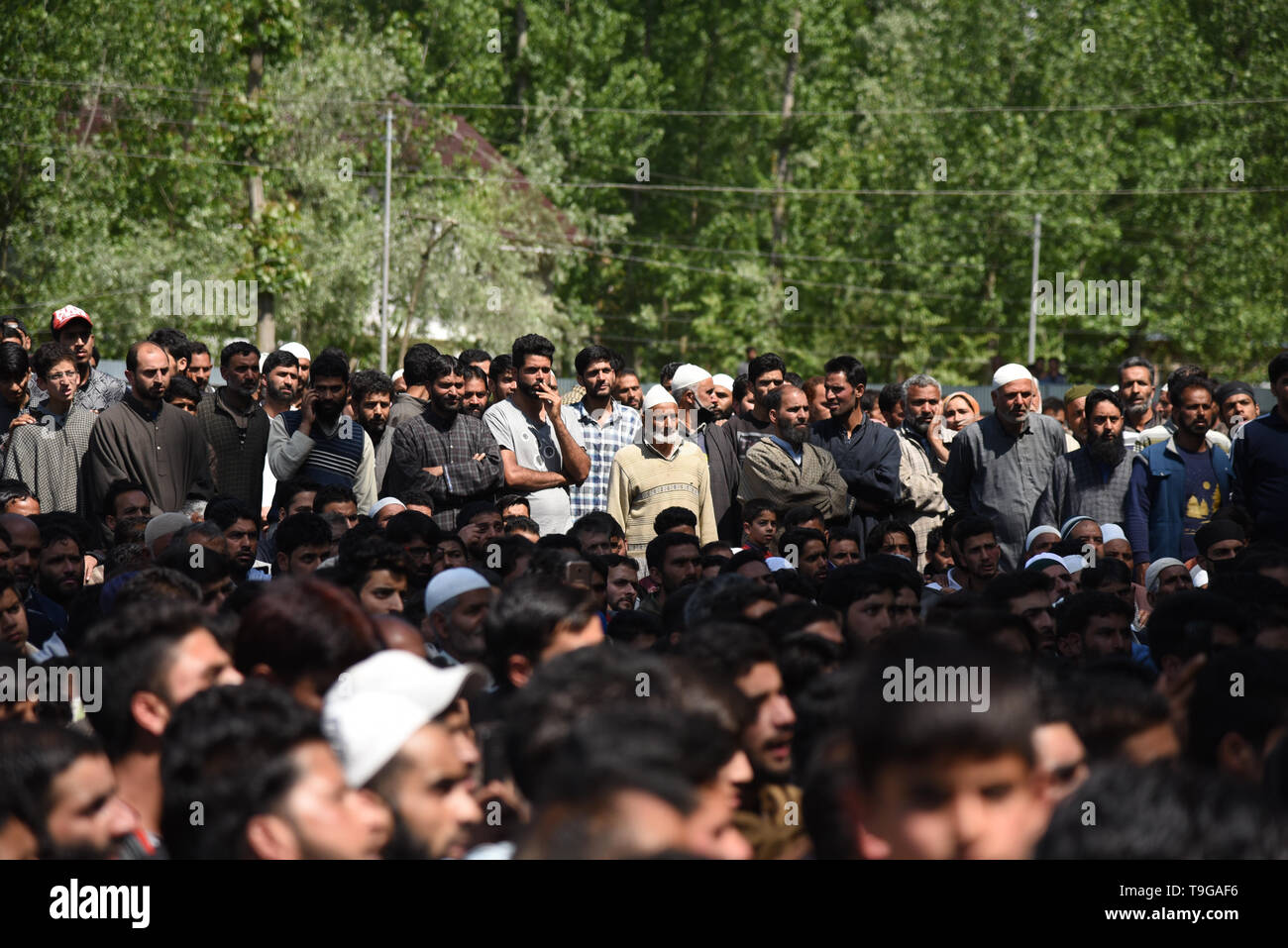 Kashmiri villagers are seen gathered during the funeral procession of Kashmiri Rebel Showkat Ahmed at his residence in Pulwama, South of Srinagar. Thousands attended the funeral ceremony of slain Showkat Ahmed Dar at his residence in Panzgam Pulwama. Showkat was among the three Kashmiri Rebels killed in a gunfight in Pulwama. - Stock Image