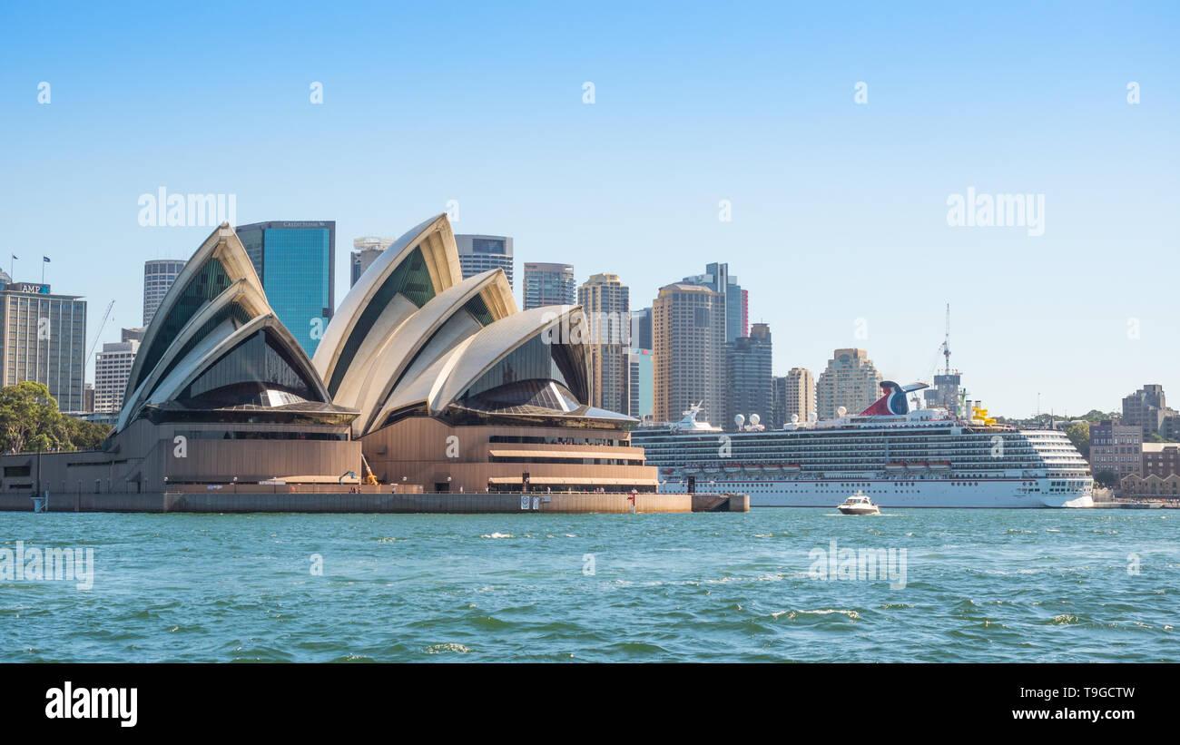 SYDNEY, AUSTRALIA - FEBRUARY 11, 2019: The Carnival Spirit cruise liner moored near Sydney Opera House, Australia's most recognisable building . Stock Photo