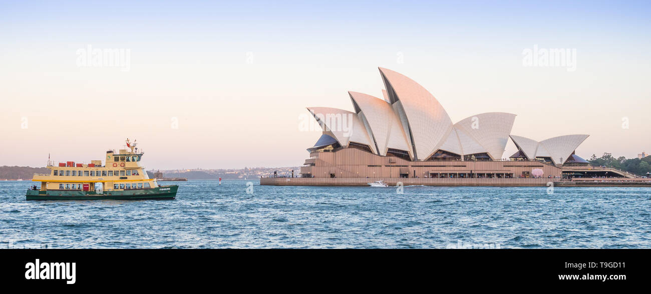 SYDNEY, AUSTRALIA - FEBRUARY 11, 2019: A ferry passing Sydney Opera House, Australia's most recognisable building and a UNESCO World Heritage Site. Stock Photo