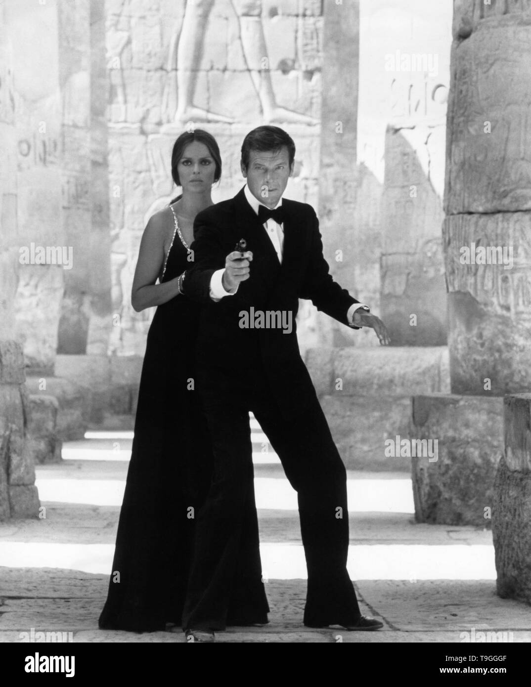 Roger Moore as James Bond 007 Barbara Bach as Russian Major Anya Amasova publicity portrait for THE SPY WHO LOVED ME 1977 director Lewis Gilbert producer Albert R. Broccoli Eon Productions / United Artists - Stock Image