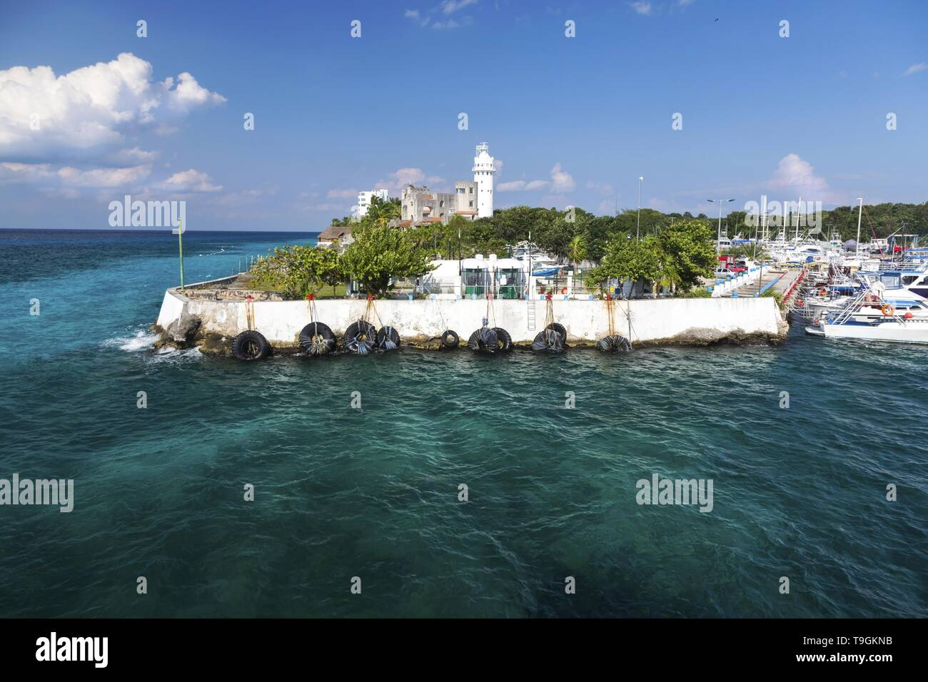 Puerto De Abrigo Sailing Ship Marina and Lighthouse over Blue Caribbean Sea Coastline on Tropical Island Cozumel Mexico Waterfront Stock Photo