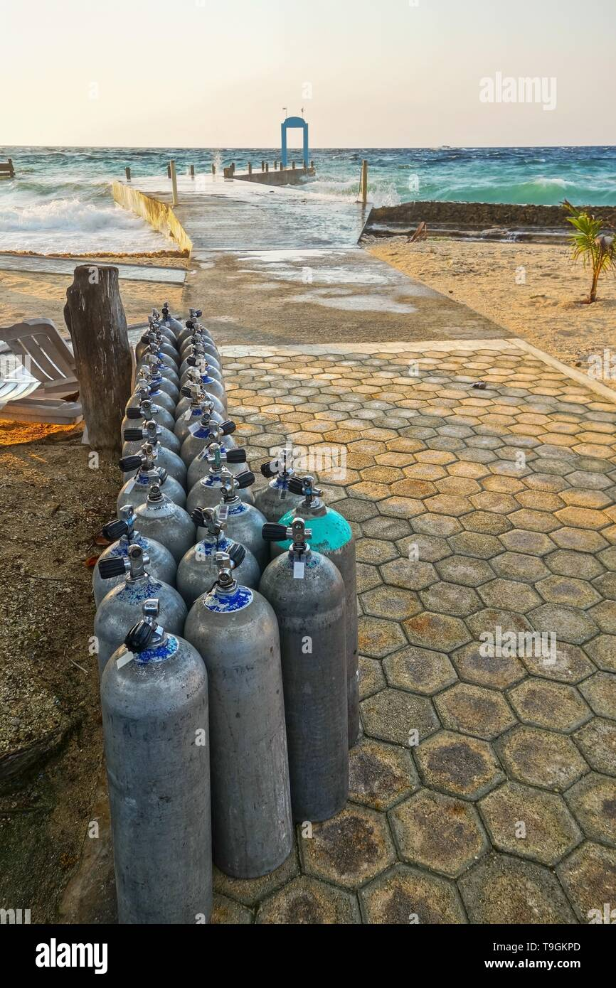 Deep Water Scuba Diving Oxygen Tanks Lined at Caribbean Beach Pier on Cozumel Mexico Waterfront Stock Photo