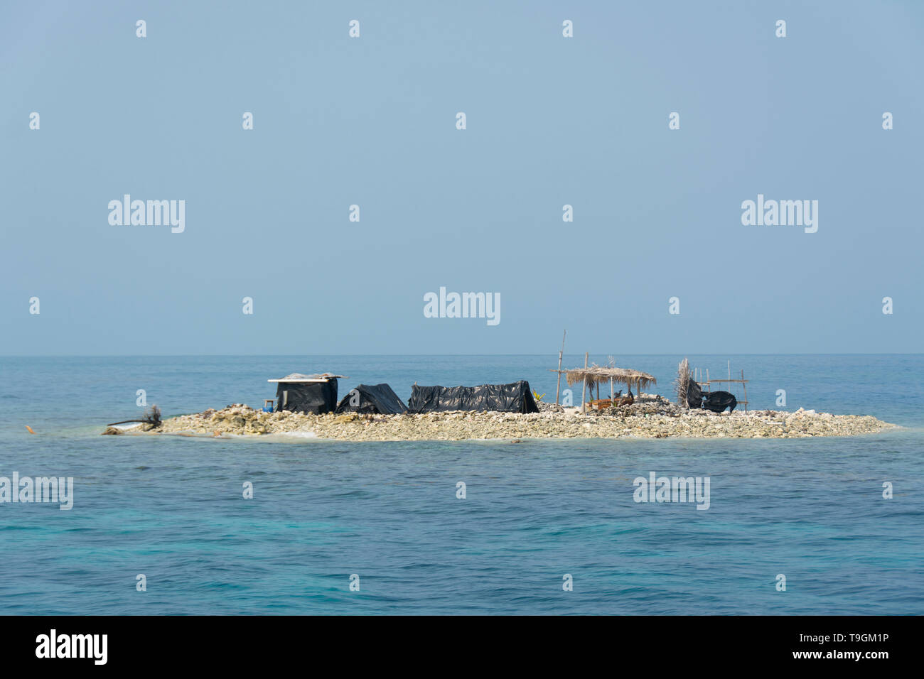 Belizean fishermen's makeshift shelters on tiny island, Belize. - Stock Image