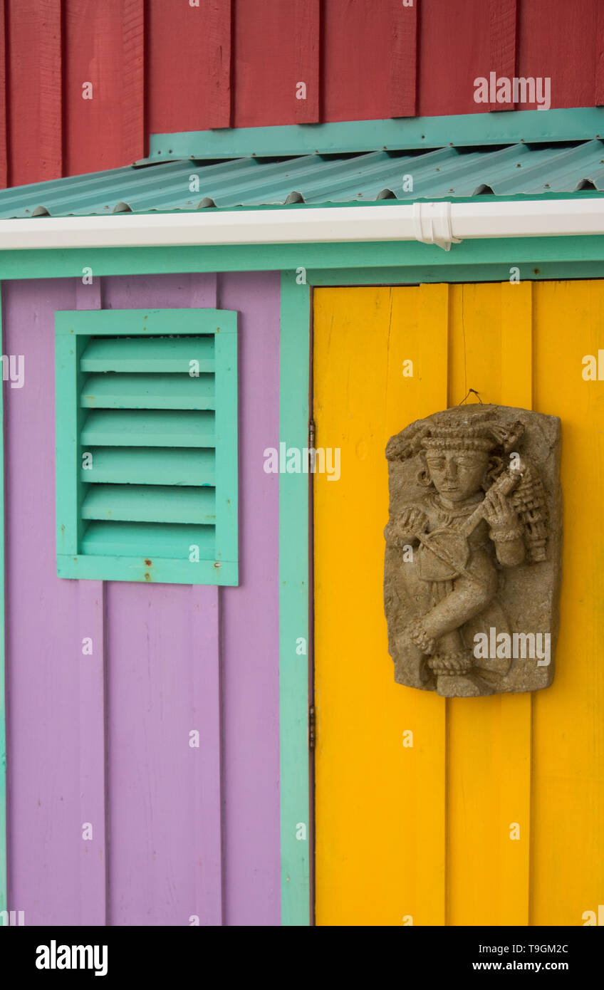 Colorful paint applications and Mayan relief, King Lewey's Island Resort, Belize - Stock Image
