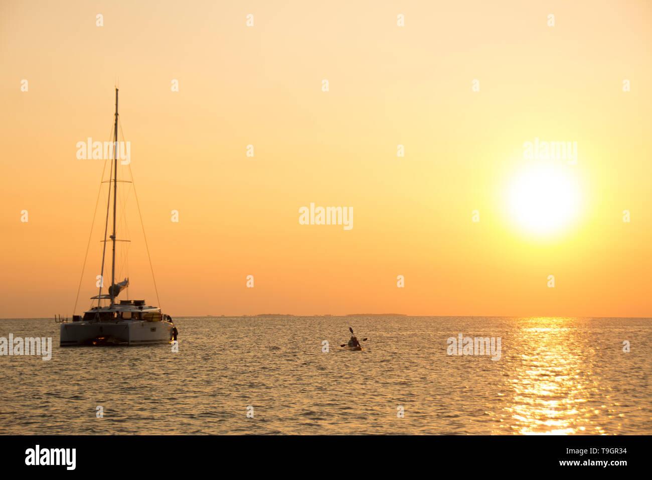 Cruising catamaran at North Long Coco Plum Caye, Belize - Stock Image
