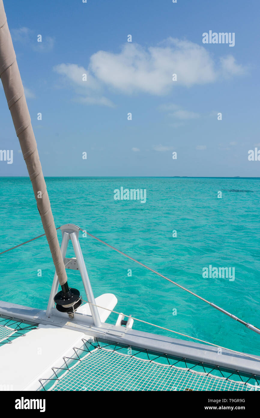 Cruising on catamaran on the Inside the Belize Barrier Reef, a series of coral reefs straddling the coast of Belize - Stock Image