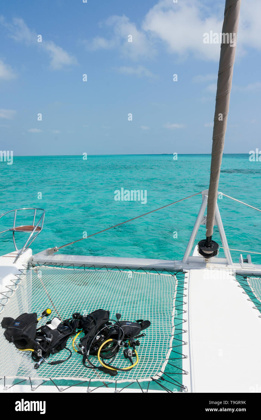 Cruising on catamaran with scuba gear, on the Inside the Belize Barrier Reef,  a series of coral reefs straddling the coast of Belize - Stock Image