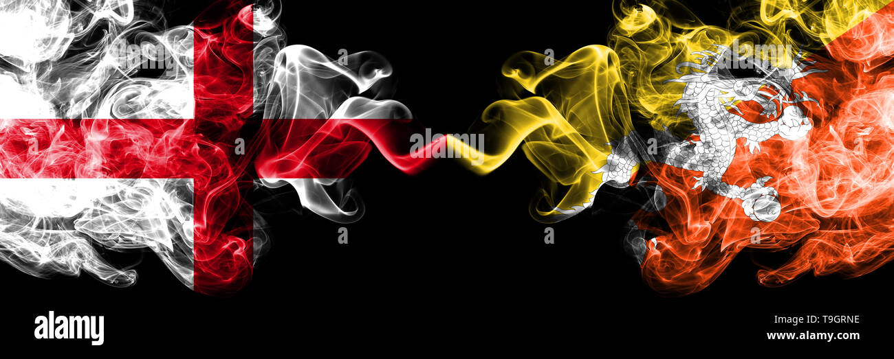 English vs Bhutan, Bhutanese smoky mystic flags placed side by side. Thick colored silky smokes flag of England and Bhutan, Bhutanese. - Stock Image
