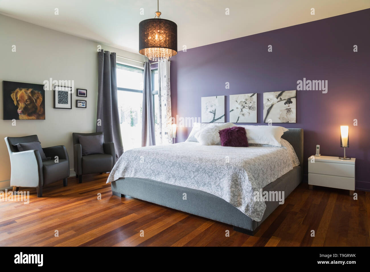 King size bed with white bedspread in upstairs master ...
