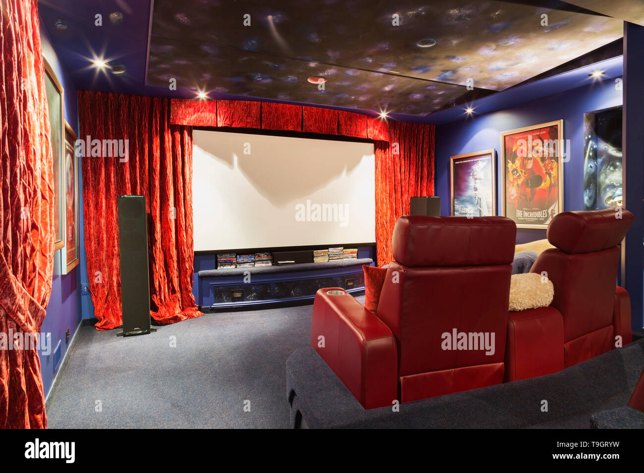 Home Theatre With Red Leather Reclining Seats In Basement