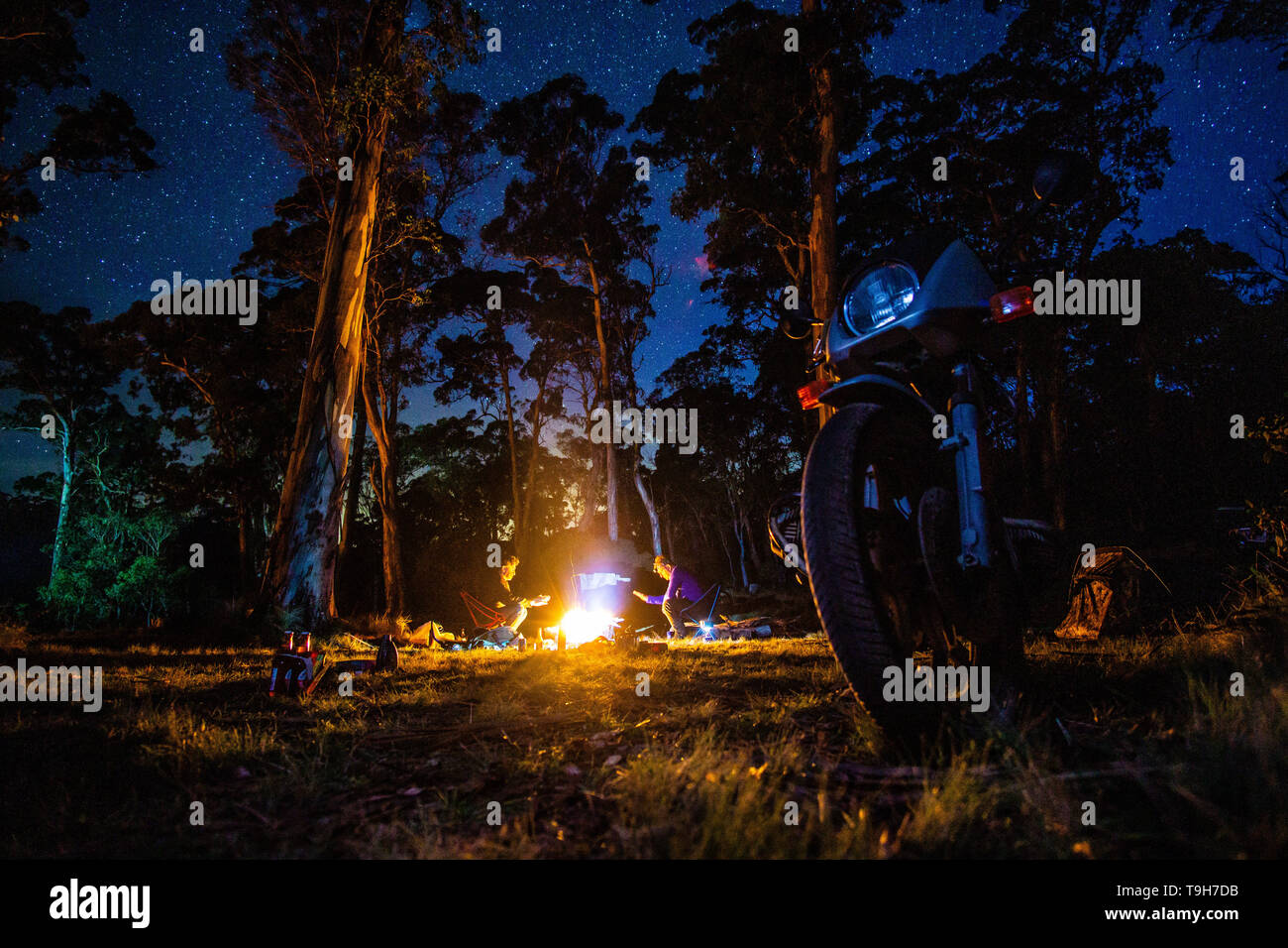 Camping under the stars during a motorcycle trip in Australia - Stock Image