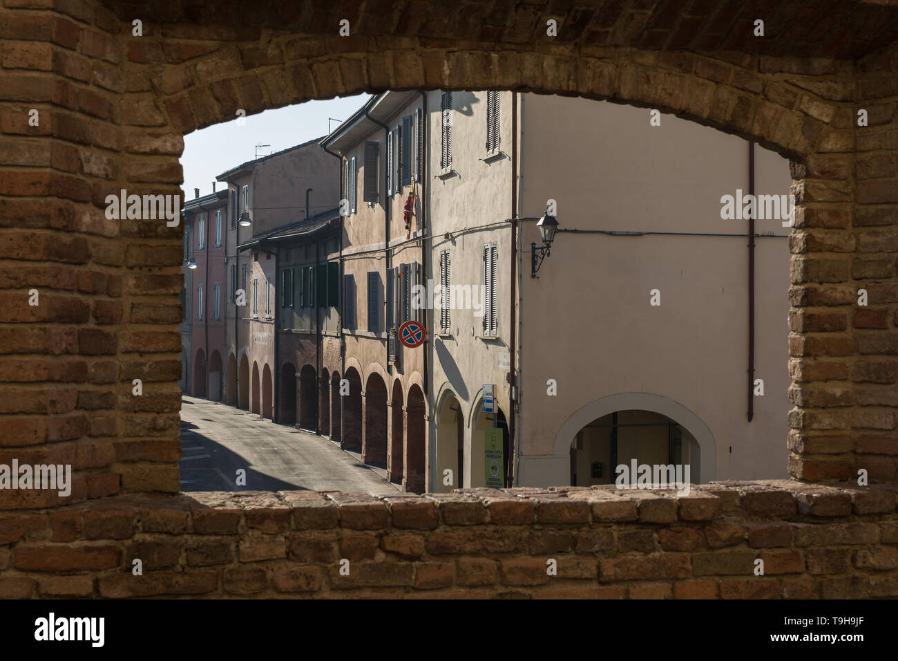 View from a Window in the Castle: Main Street, Colonnade and Houses in Fontanellato in Parma, Italy. - Stock Image