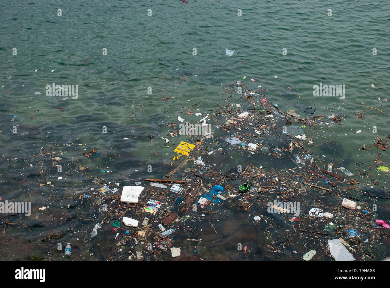 Human trash floating on the sea at Stanley Bay in Hong Kong - Stock Image
