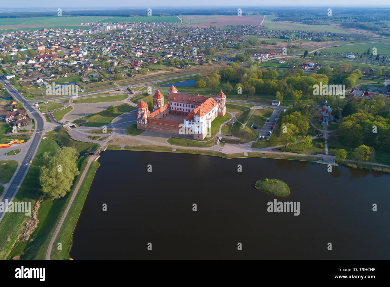 Mir Castle in the cityscape on april morning (aerial photography). Belorussia - Stock Image