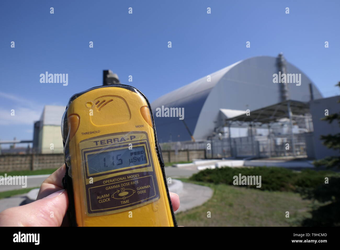 View of the Reactor 4 with a Geiger counter, inside the Chernobyl exclusion zone, Ukraine - Stock Image