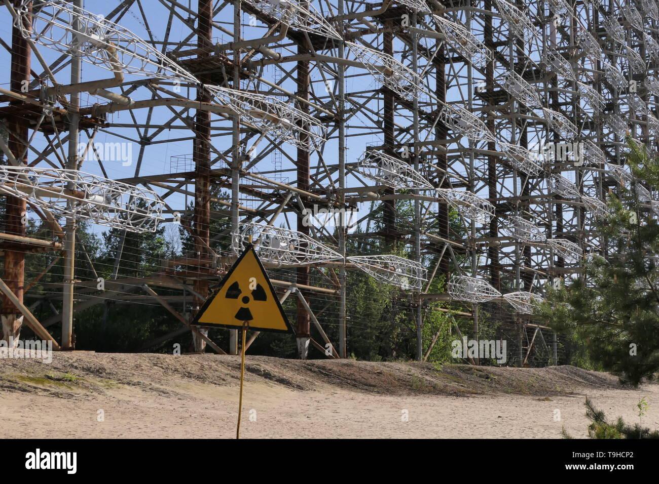 Duga 3 Soviet Radar Woodpecker System with radioactive hazard sign, Chernobyl exclusion zone, Ukraine - Stock Image