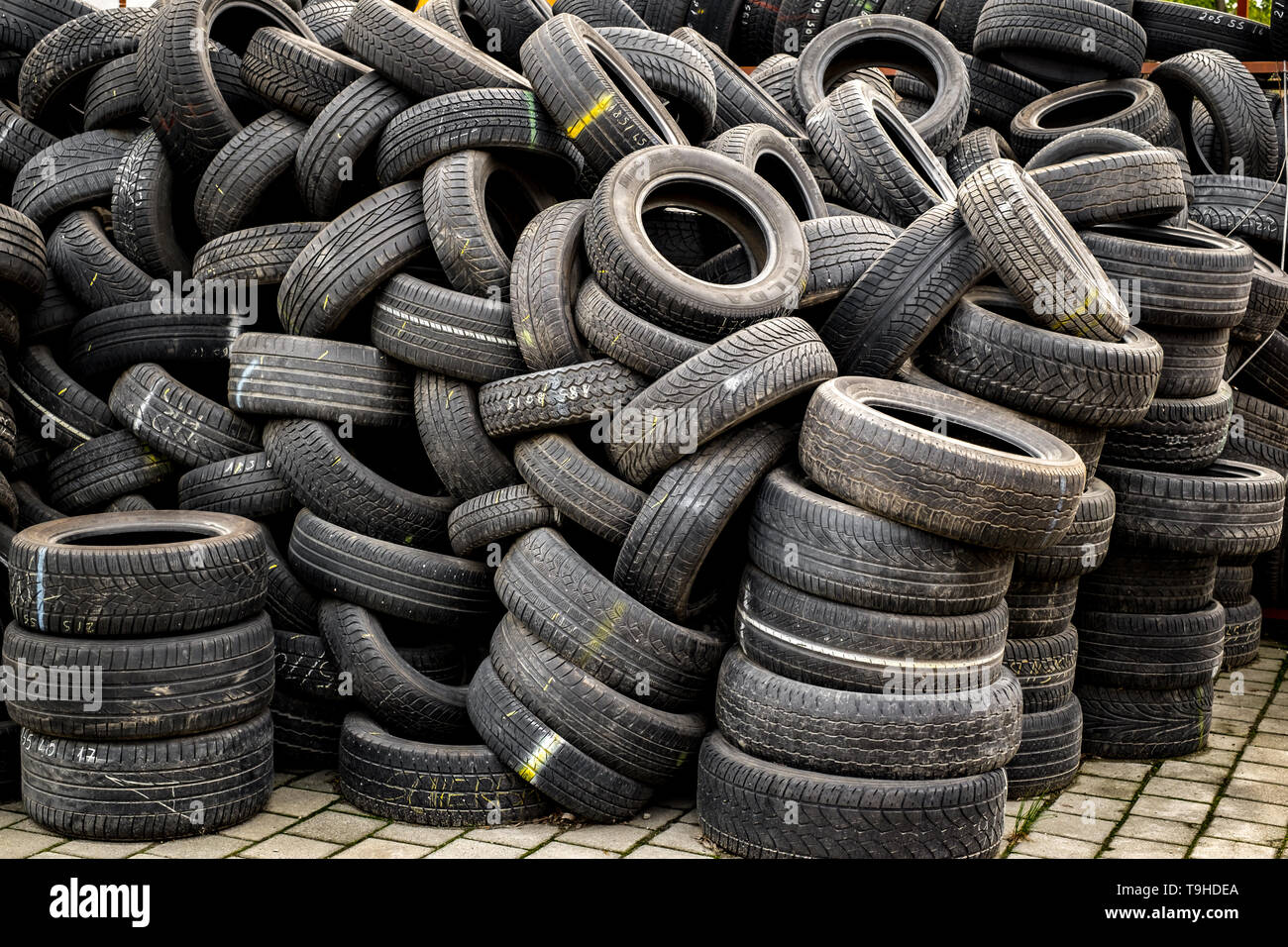 Sibiu, Romania - May 04, 2019. Used tire stacks in Workshop vulcanization yard - Stock Image