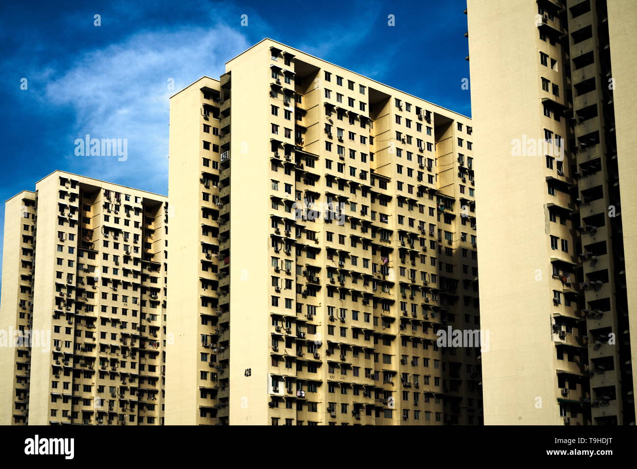 huge housing complex with three blocks of two rows each shot from below - Stock Image