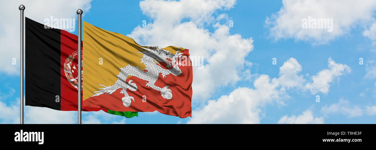Afghanistan and Bhutan flag waving in the wind against white cloudy blue sky together. Diplomacy concept, international relations. - Stock Image