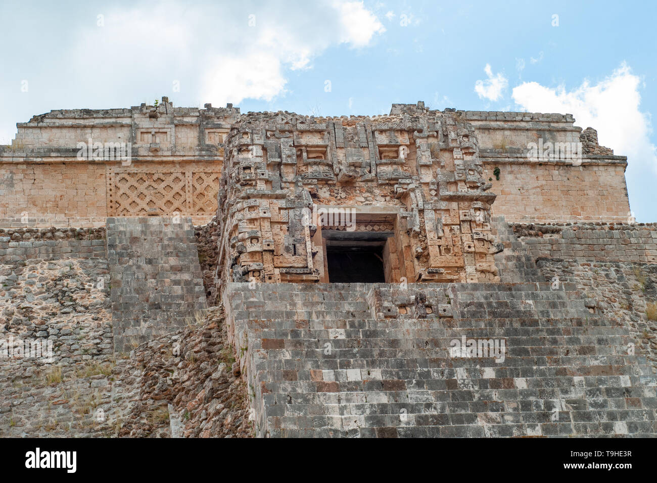 Details of the sculpted top of the Mayan pyramid, of the archaeological area of Ek Balam, on the Yucatan peninsula - Stock Image