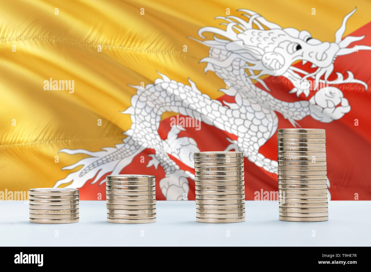 Bhutan flag waving in the background with rows of coins for finance and business concept. Saving money. - Stock Image