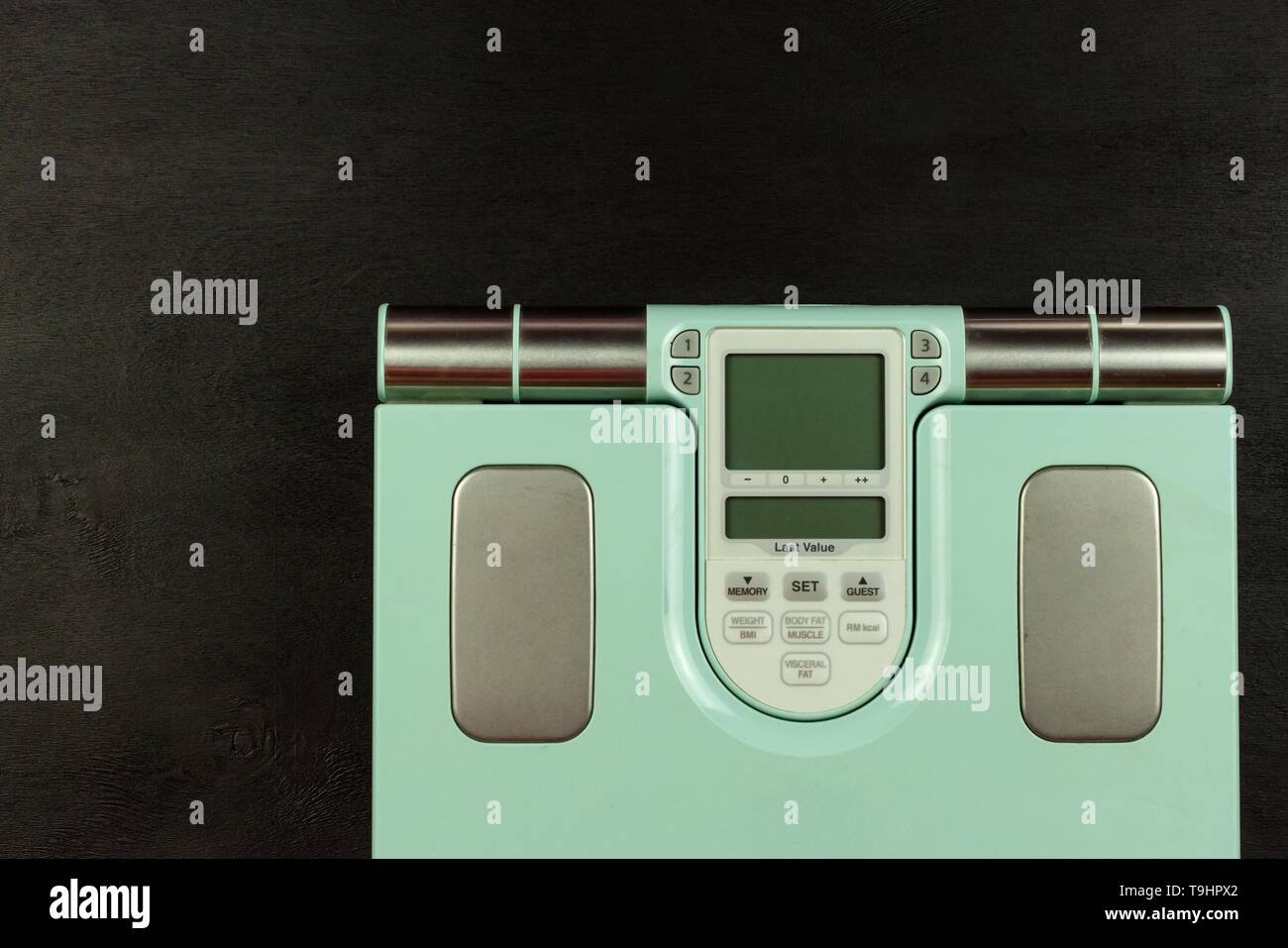 Obesity concept. Modern digital weight and legs. Weight control on diet. - Stock Image