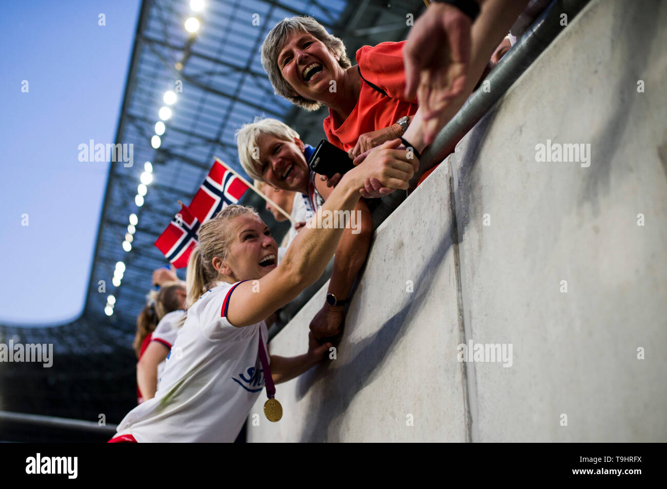 Ada Hegerberg of Lyon celebrates the victory with her family - Stock Image