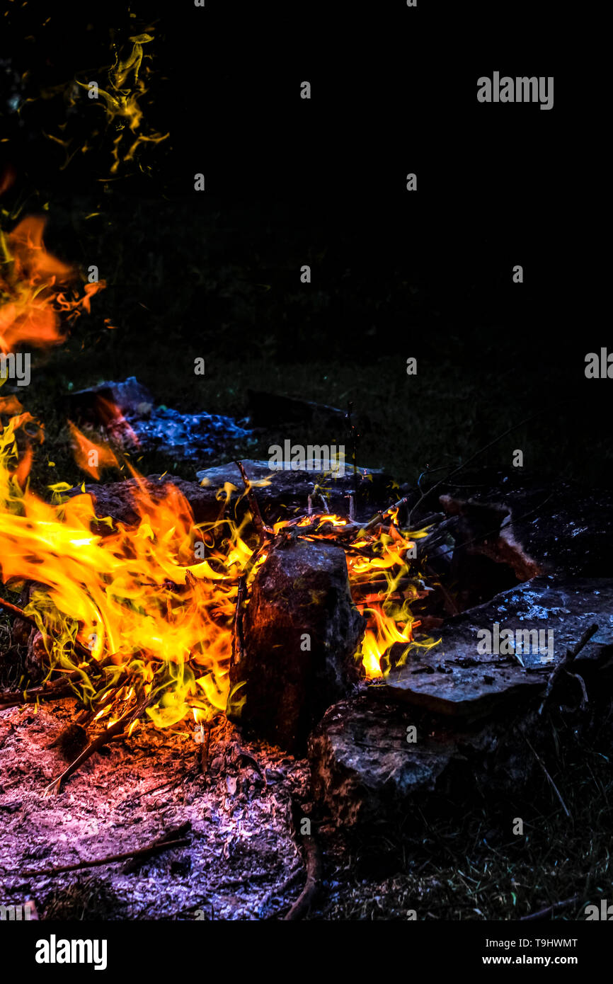 photo of a night fire in a stone ring - Stock Image