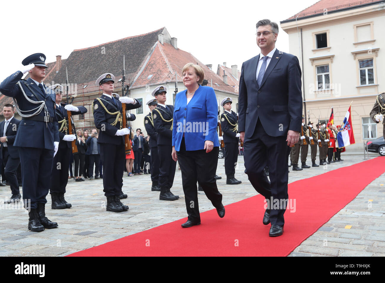 Zagreb, Croatia. 18th May, 2019. Croatian Prime Minister Andrej Plenkovic (R) and visiting German Chancellor Angela Merkel inspect the guard of honor in Zagreb, Croatia, May 18, 2019. Croatia is on the right path to entry into the Schengen area and has the support of Germany, German Chancellor Angela Merkel said here on Saturday after a formal part of the talks with Croatian Prime Minister Andrej Plenkovic. Credit: Robert Anic/Xinhua/Alamy Live News - Stock Image