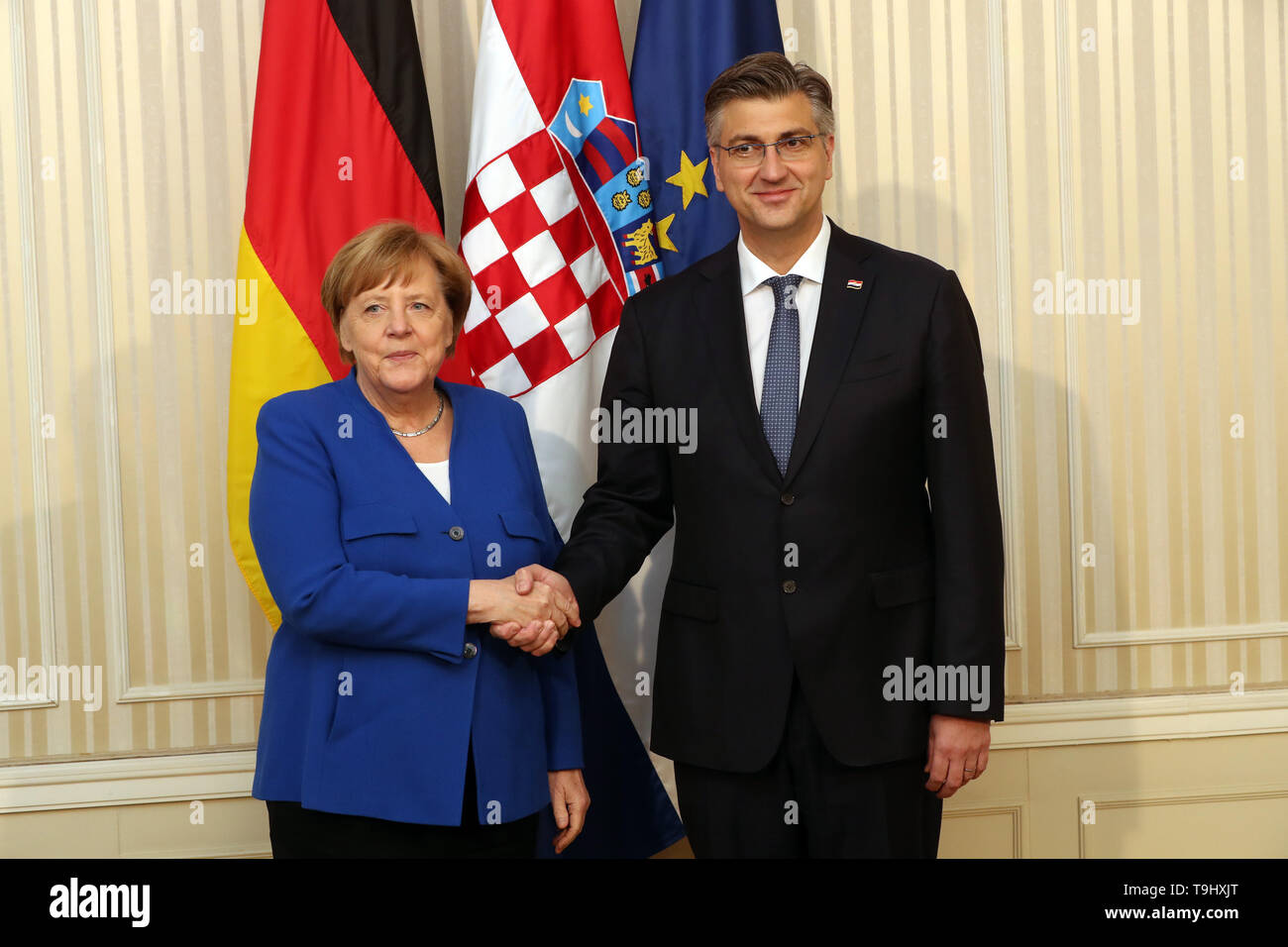 Zagreb, Croatia. 18th May, 2019. Croatian Prime Minister Andrej Plenkovic (R) shakes hands with visiting German Chancellor Angela Merkel in Zagreb, Croatia, May 18, 2019. Croatia is on the right path to entry into the Schengen area and has the support of Germany, German Chancellor Angela Merkel said here on Saturday after a formal part of the talks with Croatian Prime Minister Andrej Plenkovic. Credit: Robert Anic/Xinhua/Alamy Live News - Stock Image