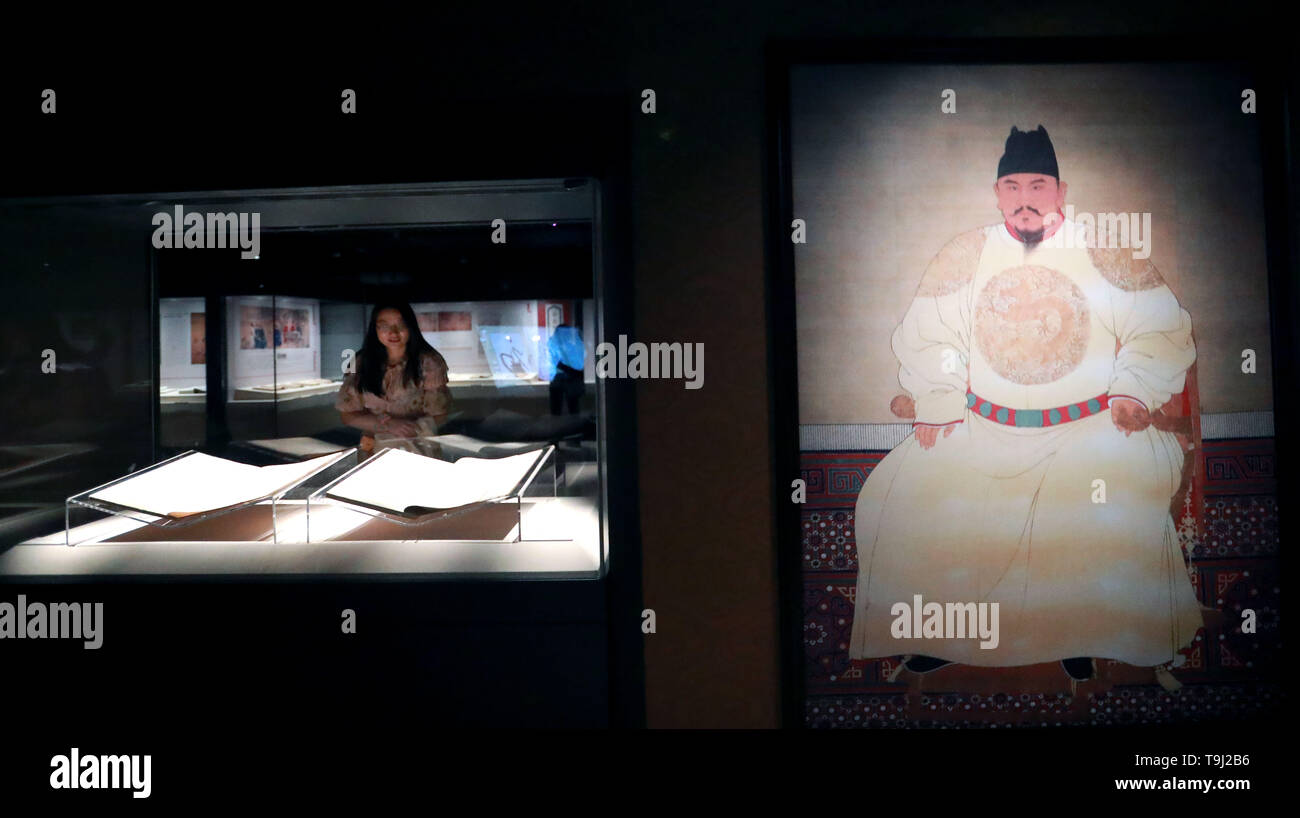 Beijing, China. 18th May, 2019. A visitor views exhibits at an exhibition on Yongle Encyclopaedia at National Library of China in Beijing, capital of China, May 18, 2019. Yongle Encyclopaedia is China's first encyclopaedia compiled in the Ming Dynasty (1368-1644). China is holding a rich variety of exhibitions and activities on the culture of Asian countries and regions as well as exchanges among them. Credit: Pan Xu/Xinhua/Alamy Live News - Stock Image
