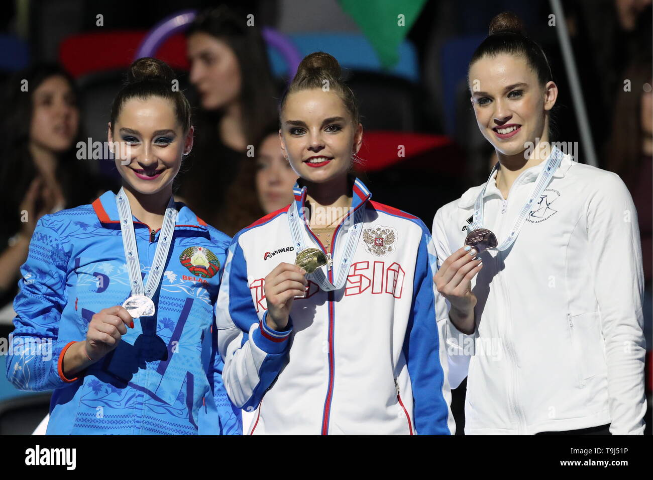 Baku, Azerbaijan. 19th May, 2019. BAKU, AZERBAIJAN - MAY 19, 2019: Silver medallis Yekaterina Galkina of Belarus, gold medallist Arina Averina of Russia, and bronze medallist Nicol Zelikman of Israel, from left, at a victory ceremony for the individual hoop routine at the 2019 European Championships in Rhythmic Gymnastics. Sergei Savostyanov/TASS Credit: ITAR-TASS News Agency/Alamy Live News - Stock Image