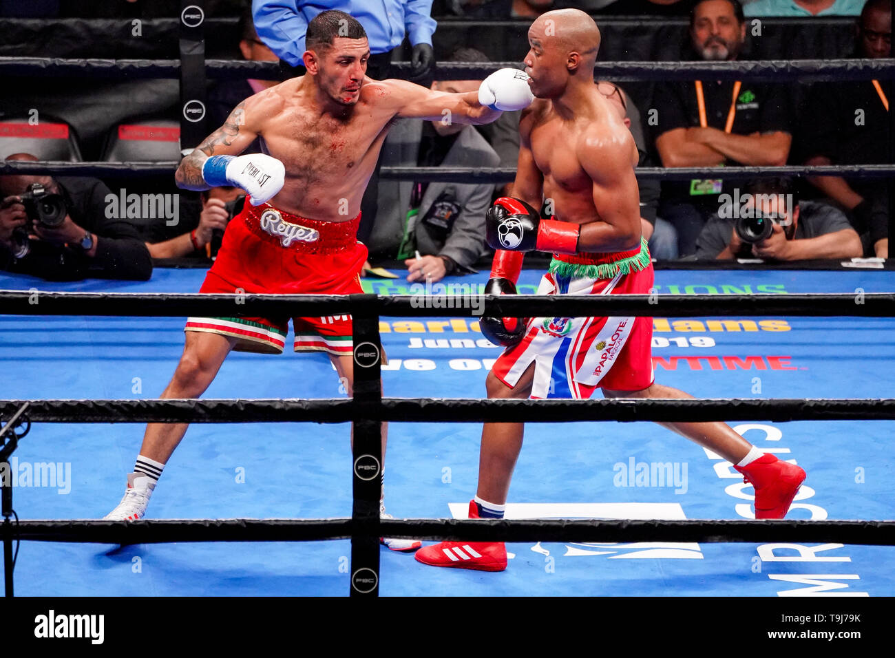 Brooklyn, New York, USA. 18th May, 2019. JUAN HERALDEZ (red with white, green, and red trim trunks) battles ARGENIS MENDEZ in a super lightweight bout at the Barclays Center in Brooklyn, New York. The fight ended in a majority draw. Credit: Joel Plummer/ZUMA Wire/Alamy Live News - Stock Image