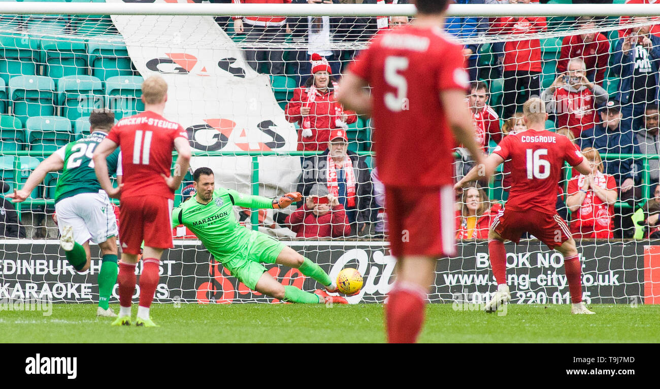 Edinburgh, Scotland, UK. 19th May 2019. Ofir Marciano of Hibernian  saves Sam Cosgrove penalty during the Ladbrokes Premiership match between Hibernian and Aberdeen at Easter Road on May 19 2019 in Edinbugh, UK. Editorial use only, licence required for commercial use. No use in Betting, games or a single club/league/player publication. Credit: Scottish Borders Media/Alamy Live News - Stock Image