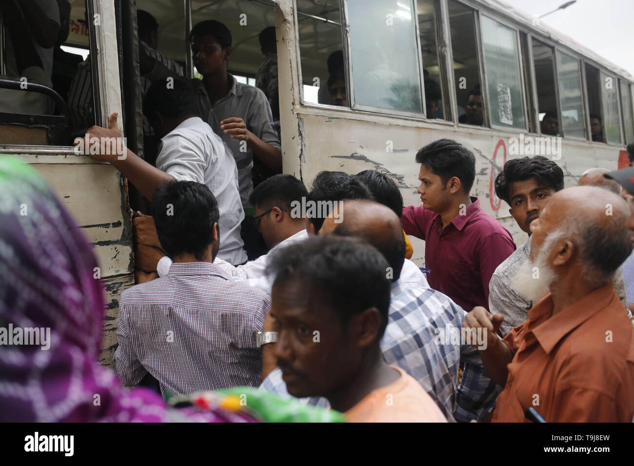 May 19, 2019 - Dhaka, Bangladesh - Commuters busy to inter in a public transport on a rush hour during Ramadan in Dhaka. Passenger transport service is very incomprehensible for commuters in the capital. (Credit Image: © MD Mehedi Hasan/ZUMA Wire) Stock Photo