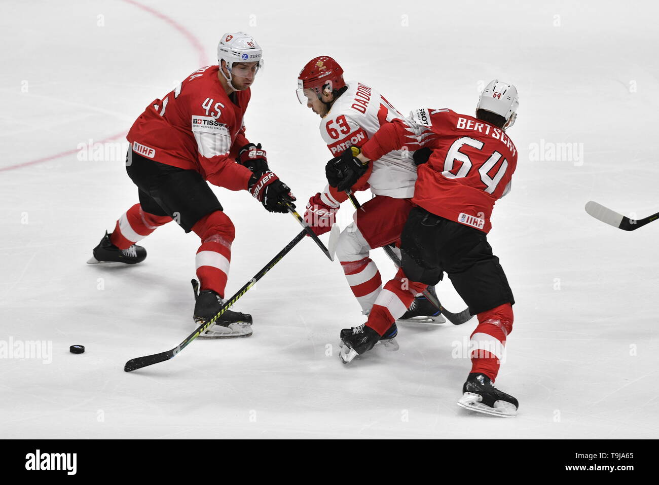 Bratislava, Slovakia. 19th May, 2019. L-R Michael Fora (SUI), Yevgeni Dadonov (RUS) and Christoph Bertschy (SUI) in action during the match between Switzerland and Russia within the 2019 IIHF World Championship in Bratislava, Slovakia, on May 19, 2019. Credit: Vit Simanek/CTK Photo/Alamy Live News Stock Photo
