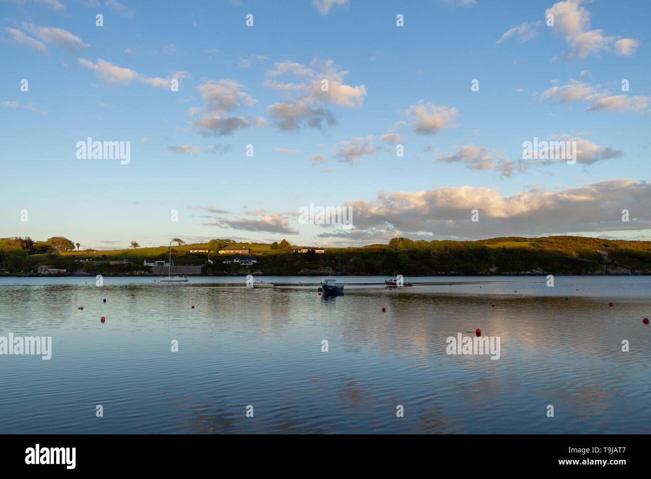 Castletownshend, West Cork, Ireland, 19th May 2019, After a fine sunny day the sunsets over a calm Castletownshend Harbour, the weather set for much of the same tomorrow with long sunny spells. Credit aphperspective/ Alamy Live News - Stock Image