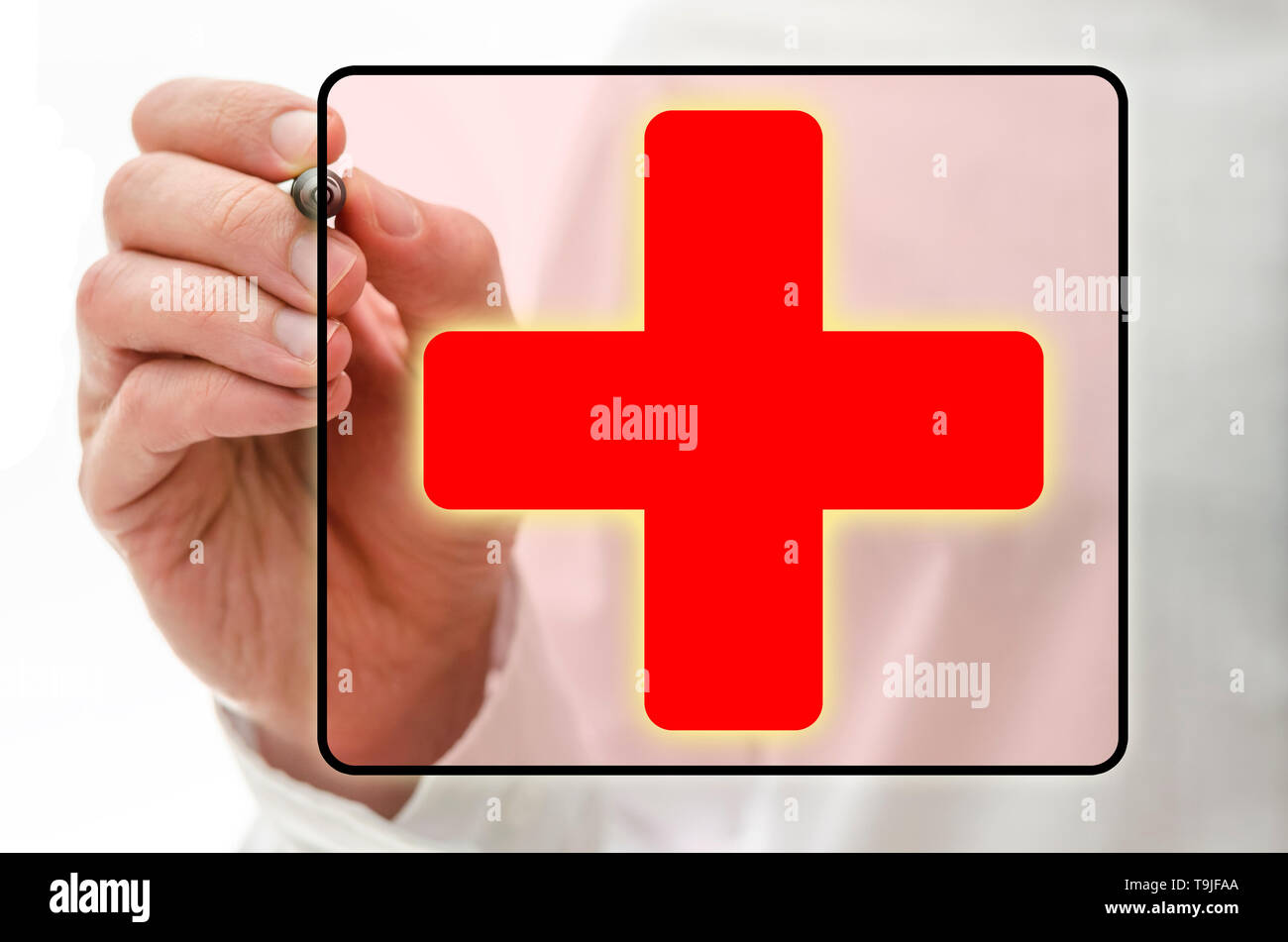 Red cross on virtual screen. Medical care concept. - Stock Image