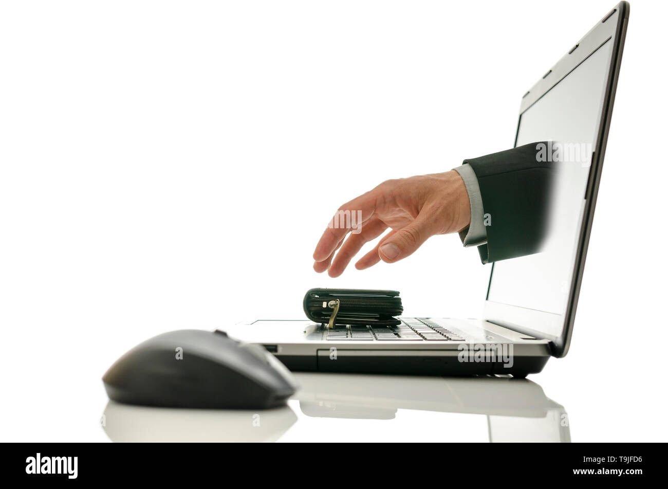 Hand coming out of laptop screen stealing wallet. Concept of internet theft. - Stock Image