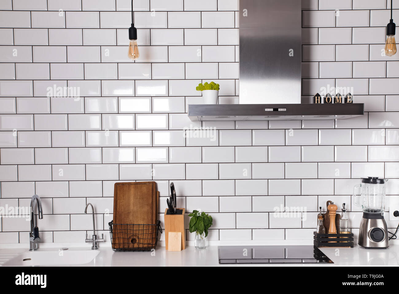 Modern Kitchen With Brick White Tile Wall And Differet Utensils On The Counter Stock Photo Alamy