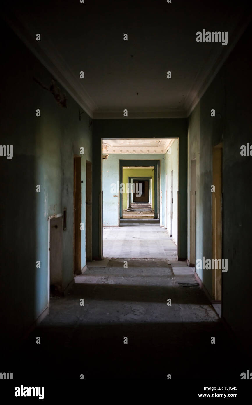 View at ruined hallway in the abandoned building - Stock Image