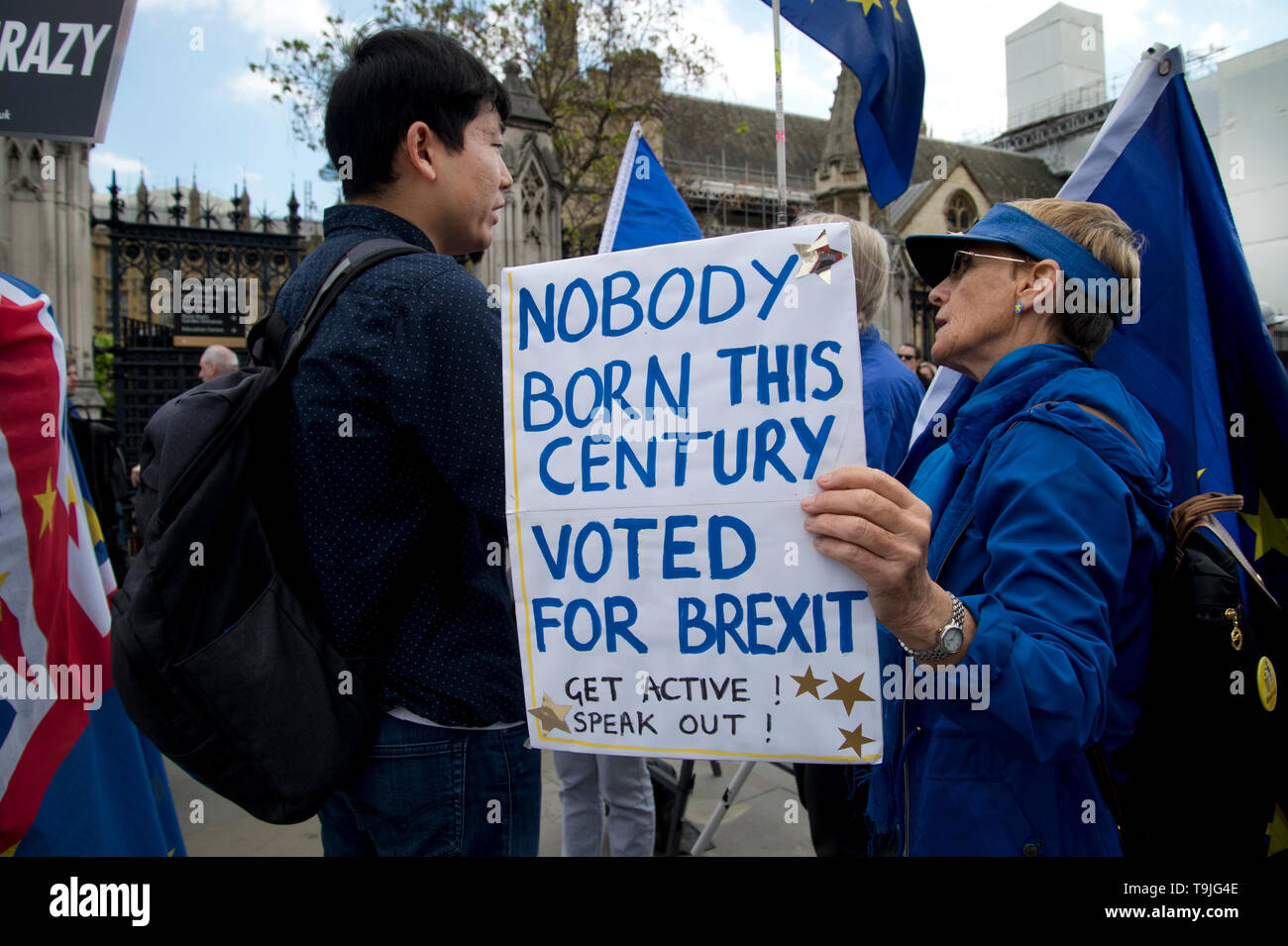Parliament Square, Westminster, London. May 17th 2019. A Remain activist talks to a passer-by and holds a placard saying 'Nobody born this century vot - Stock Image