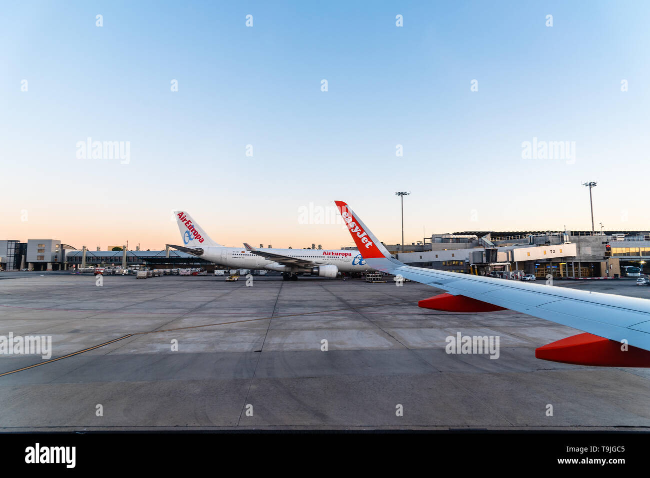 Madrid, Spain - May 14, 2019:  Airplanes in runway of international airport of Madrid a clear day at sunrise Stock Photo
