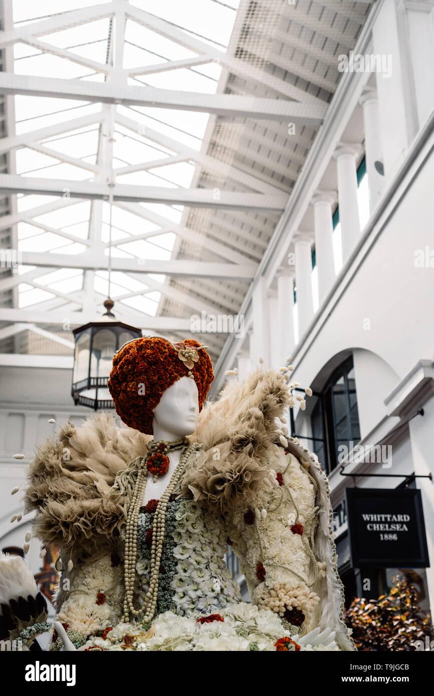 London, UK - May 15, 2019: Fleurs de Villes Floral Couture Installation in Covent Garden Market Building. Stock Photo