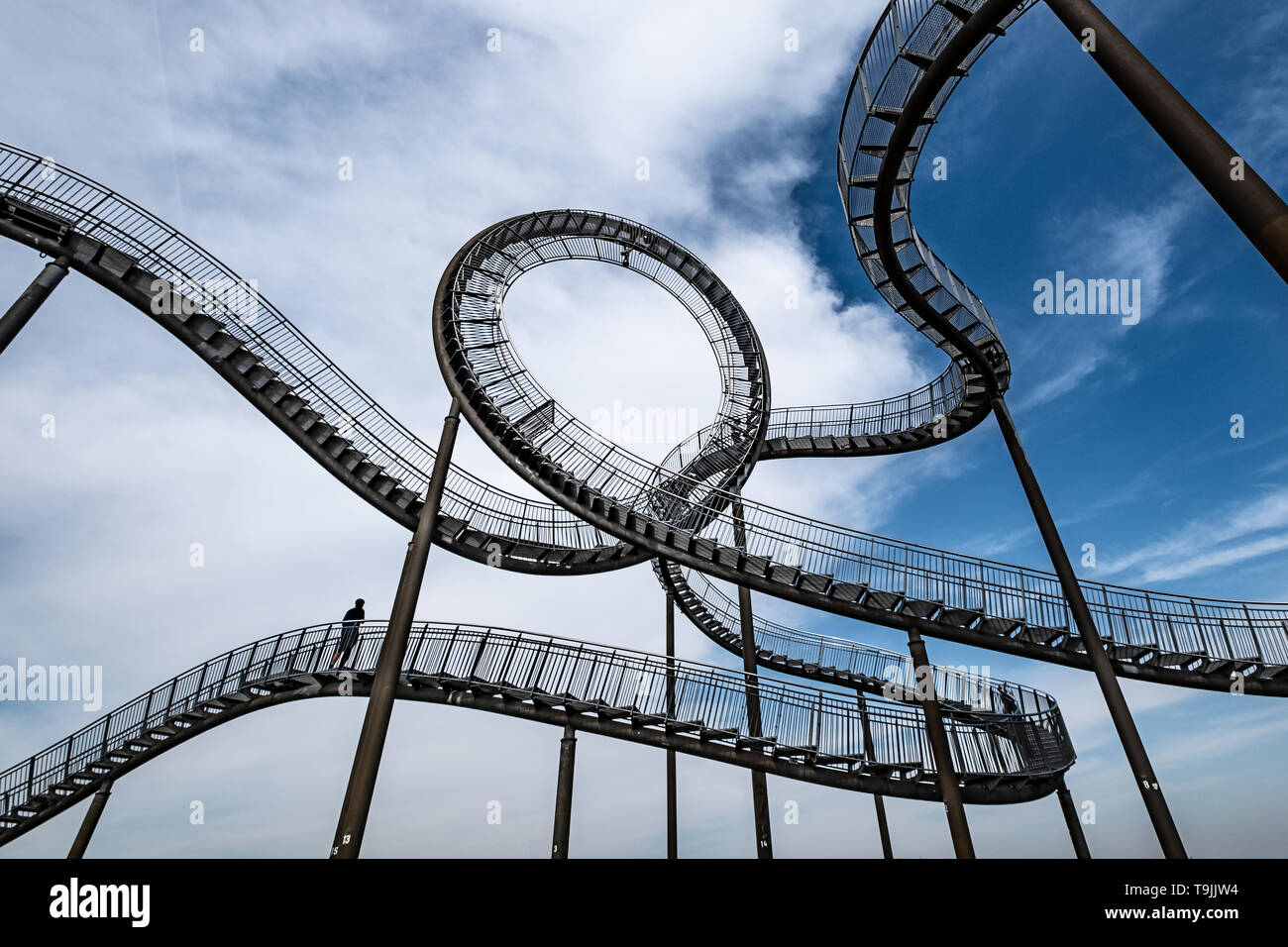 Tiger and turtle magic mountain in Duisburg Germany. Man standing on a huge steel construction in form of a rollercoaster - Stock Image