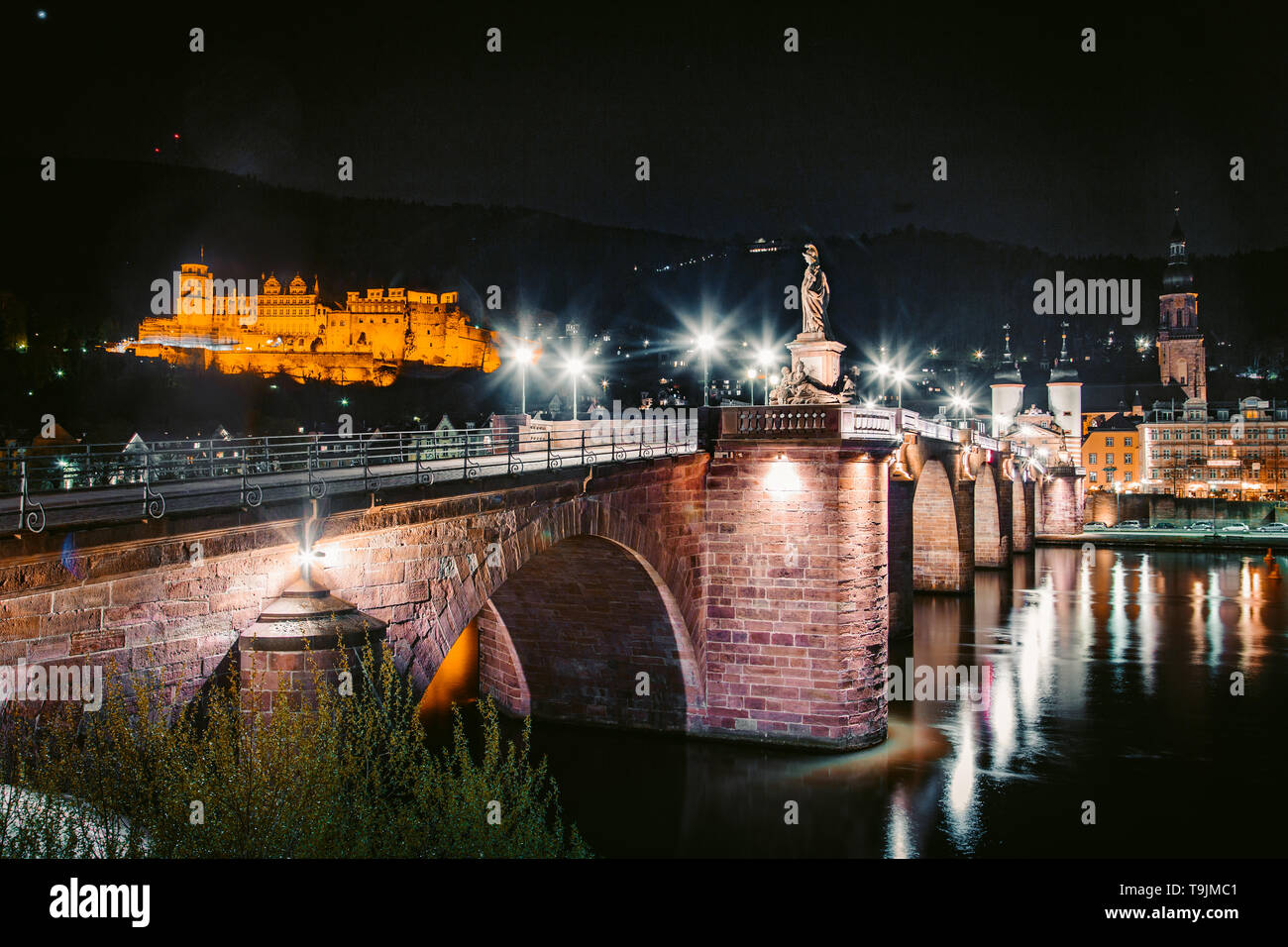 Panoramic view of the old town of Heidelberg reflecting in beautiful Neckar river at night, Baden-Wuerttemberg, Germany - Stock Image