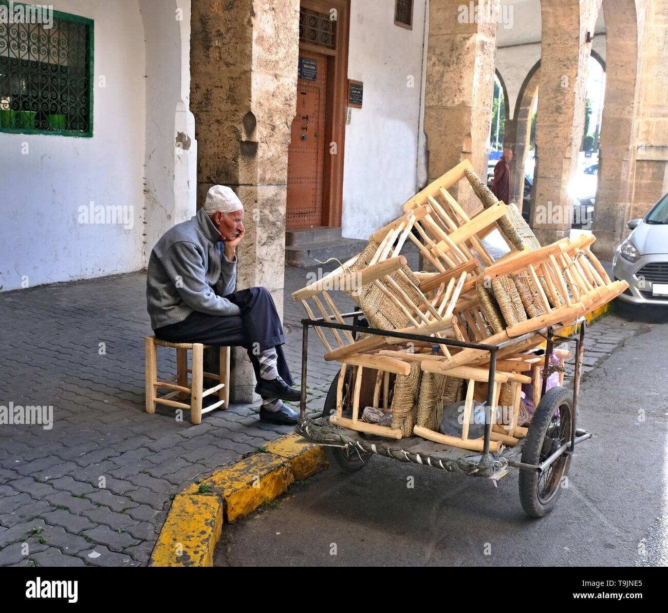 March 10, 2019, Casablanca, Morocco: Craftsman, carpenter, manufacturing chairs and selling their goods on the streets of Casablanca in Morocco - Stock Image
