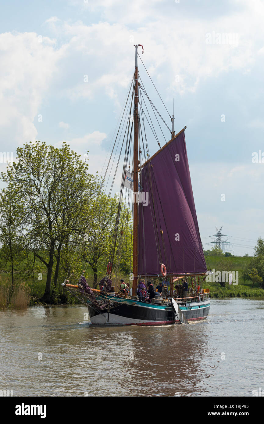Stade, Germany - May18, 2019: Historic flat-bottomed sail boat Wilhelmine von Stade on Schwinge river. - Stock Image