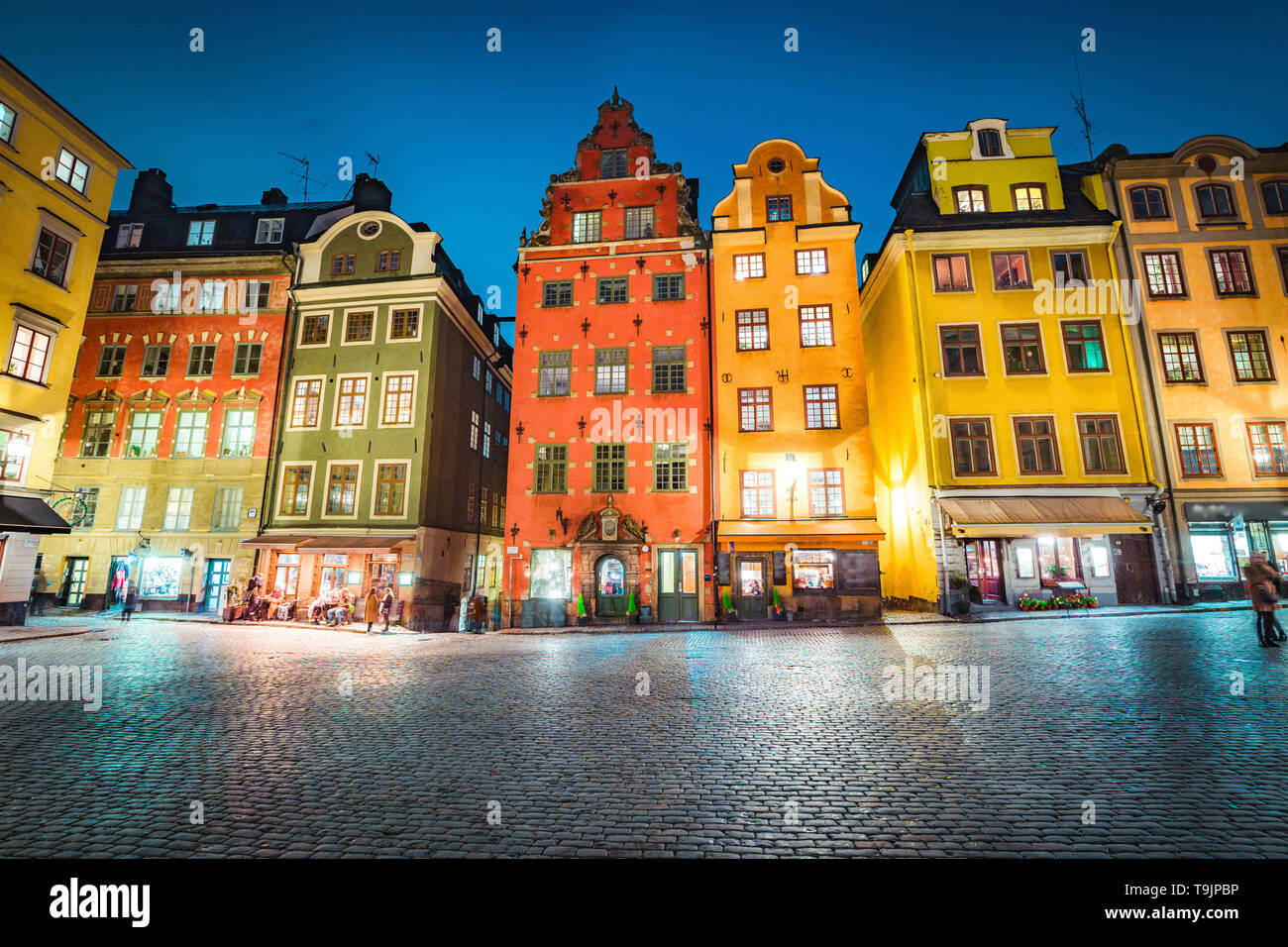 Classic view of colorful houses at famous Stortorget town square in Stockholm's historic Gamla Stan (Old Town) at night, central Stockholm, Sweden - Stock Image